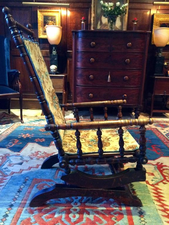 A late 19th century Victorian mahogany American rocking chair armchair with  bobbin spindles to the arms - Antique Armchair American Rocking Chair Mahogany 19th Century