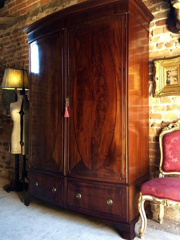A beautiful and very striking 20th century Edwardian mahogany slightly bow  fronted wardrobe with two hinged - Antique Edwardian Wardrobe Mahogany Armoire At 1stdibs