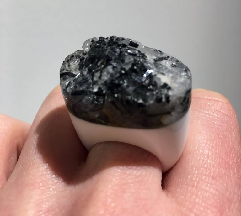 This grey granite ring (size 7) was designed by Aureliano and Melba Palmeri for Pulowi.   Since the founding of Pulowi in 2002, Aureliano and Melba Palmeri have sought to combine his Italian heritage with her Wayuu culture through the embodiment
