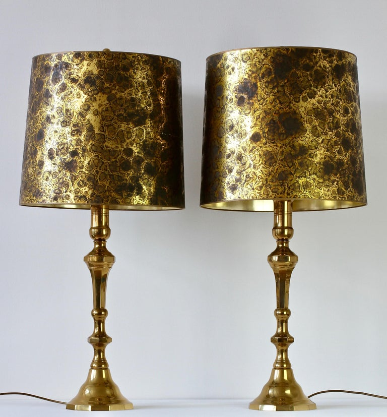 Monumental and tall Mid-Century Modern pair of oversized, large-scale table or floor lamps in the style of Maison Jansen, circa 1970s. Featuring cast polished brass, these lamps lend themselves to any modern home decor as well as the Mid-Century