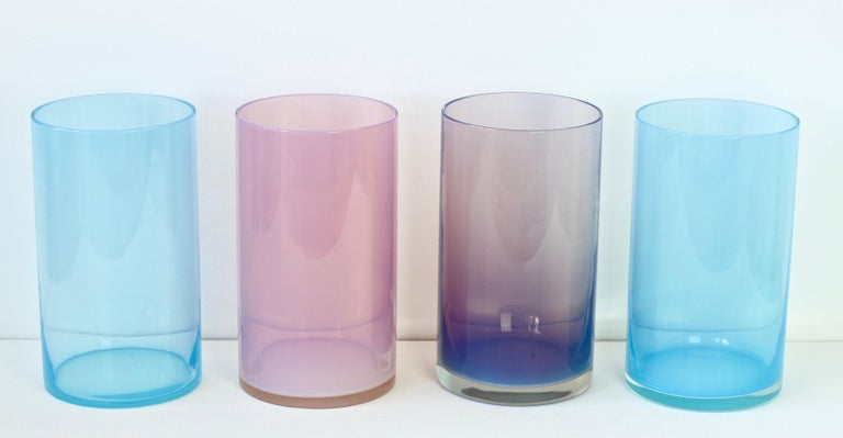 Signed midcentury, vintage set or ensemble of four 'Opalino' Murano glass vases or vessels designed by Antonio da Ros for Cenedese, circa 1970-1990 Wonderful translucent colors (colours) of vibrant blues, aubergine and pink. Simplistic yet elegant
