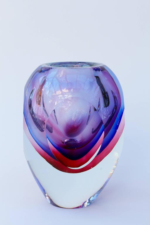 A stunning, large, vibrant and colorful (colourful) mouth blown Murano art glass bowl or vase by Flavio Poli for Seguso, circa 1960s. Absolutely exceptional in every way utilising the Sommerso technique featuring lilac over cobalt blue over rose