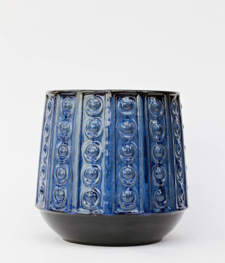 A beautiful, large plant pot or flower vase in striking blue over dark, almost black, brown glaze with an embossed pattern - shape number 4121-20, produced by Jasba Pottery in the mid-1970s.  This vase makes a fantastic, striking statement when