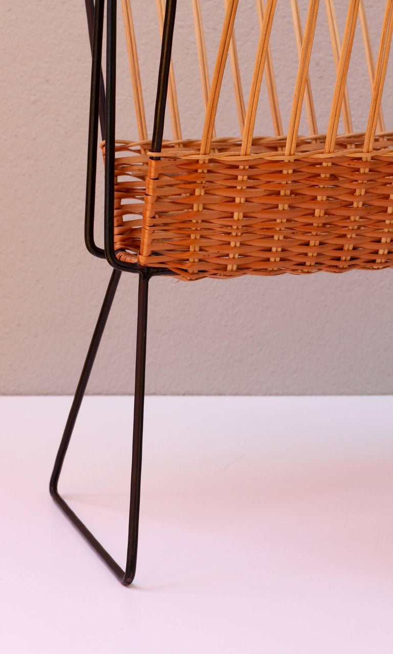 Rattan Mid-Century Modernist Wicker Magazine Rack Stand Attributed to Carl Auböck For Sale