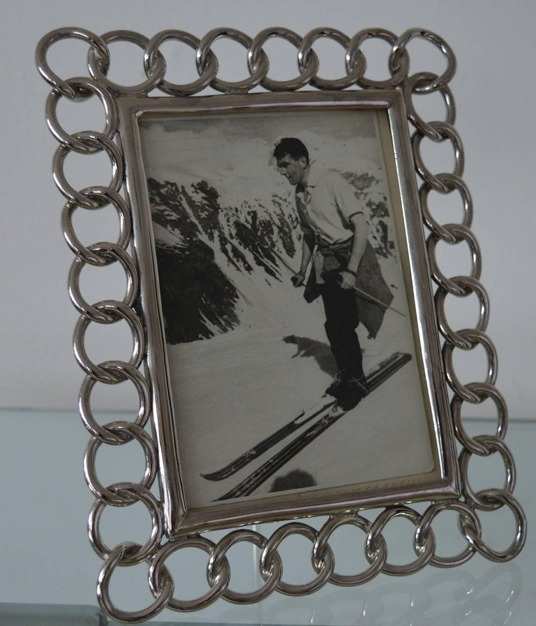 Very stylish nickel-plated brass ring photograph frame.  Recently re-plated.  Makes a great desk accessory.  Takes a photograph of 6 x 4 inches.