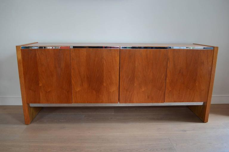 A rare and high quality 1970s Merrow Associates sideboard with chrome-plated steel trim designed by Richard Young for Merrow Associates, England.