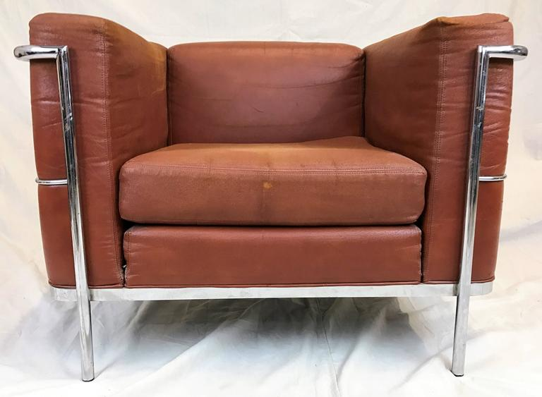 Pair Of Mid Century Modern Lounge Chairs In An Upholstered Rust Colored  Faux Leather