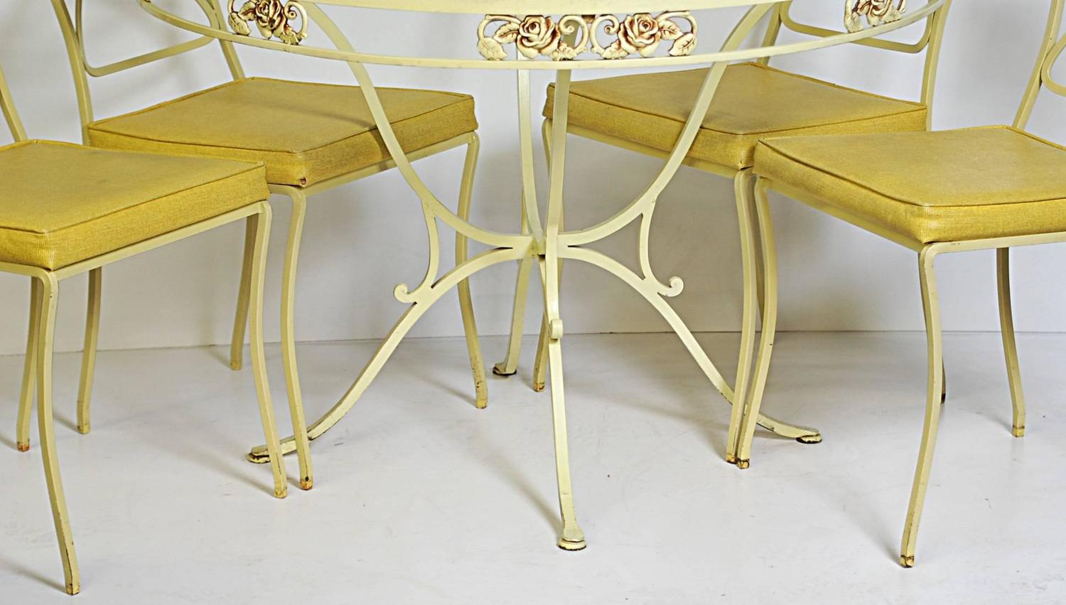 five piece wrought iron dining patio set yellow painted with a floral