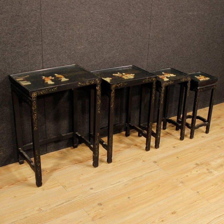 Set of French side tables from the 20th century. Beautiful furniture in lacquered and painted wood with soap stone decorations. Set consisting of four tables with glass tops, of a fair size and service. Side tables ideal to be inserted in a living