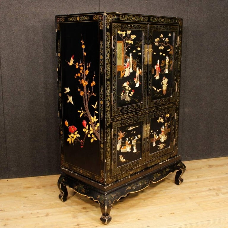 French sideboard of the 20th century. Furniture composed of two elements (basement and sideboard) richly lacquered, painted and decorated with soapstone chinoiserie decorations. Four-doors sideboard of excellent capacity and service missing internal