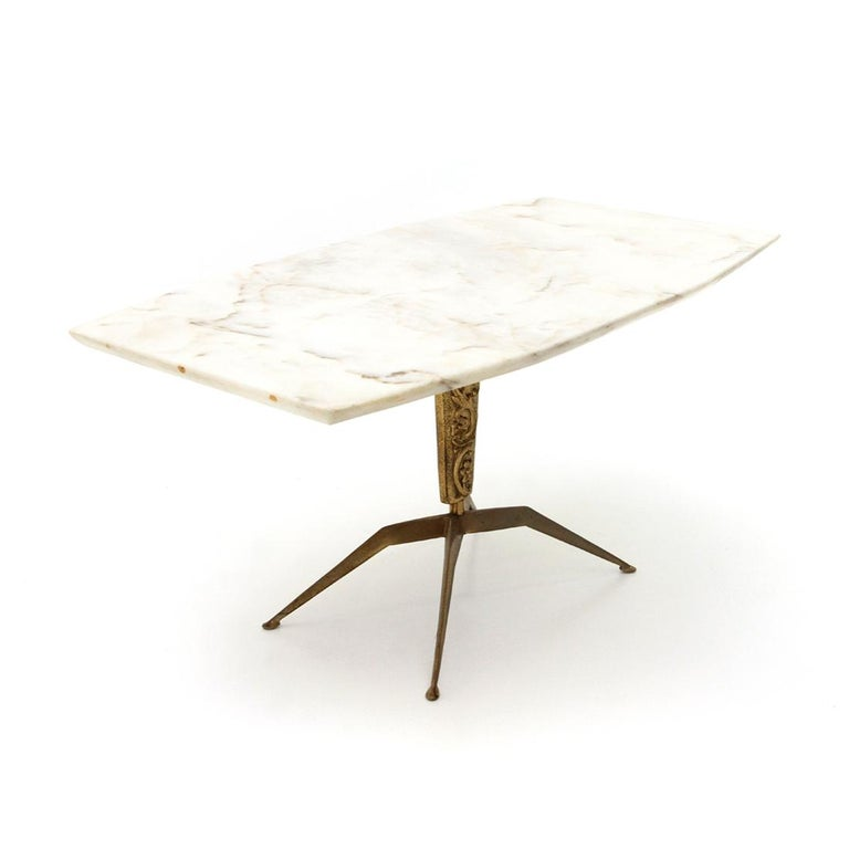 Italian manufacturing table from the 1950s. Marble-top with tapered edge. Brass base with decorative pattern. Good general conditions, some signs due to normal use over time.  Dimensions: Length 87 cm, depth 48 cm, height 43 cm.