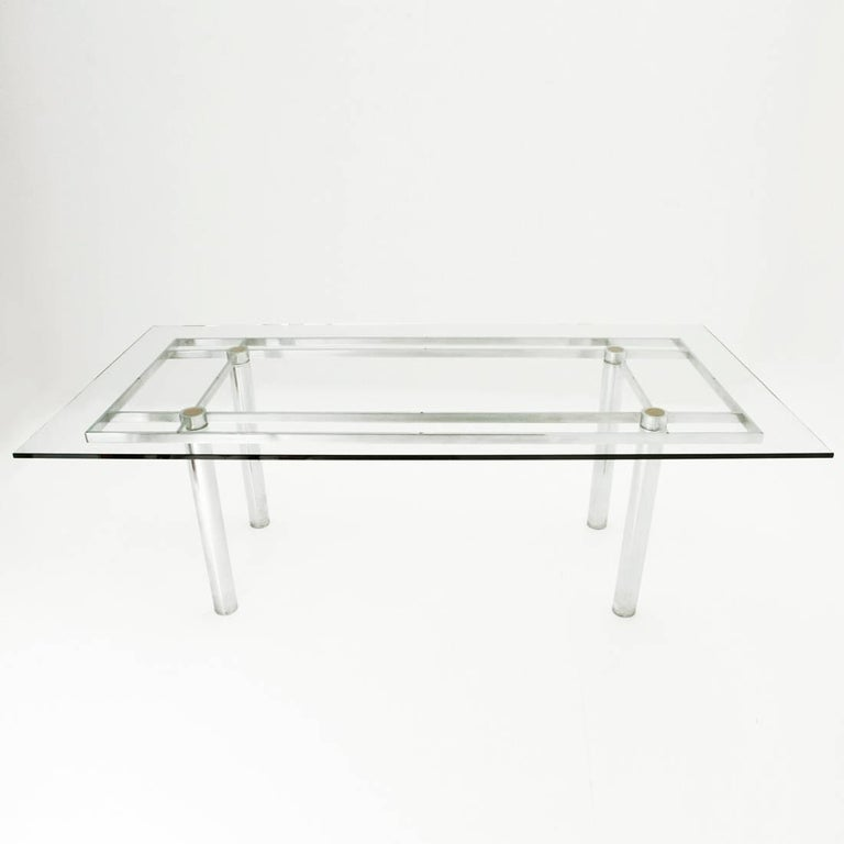 Large rectangular table designed by Tobia Shoe for Gavina in the 1960s. Solid metal frame in chromed metal, thick glass top, feet and rests top, in leather. Good general conditions, some signs due to normal use over time.  Dimensions: Width 202