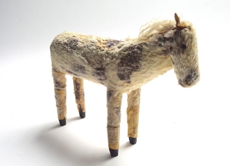 Unique horse Folk Art sculpture. Handmade and wrapped in leather and horse hair. Black wood tips to legs. Some hair loss. One of a kind piece. Good vintage condition.