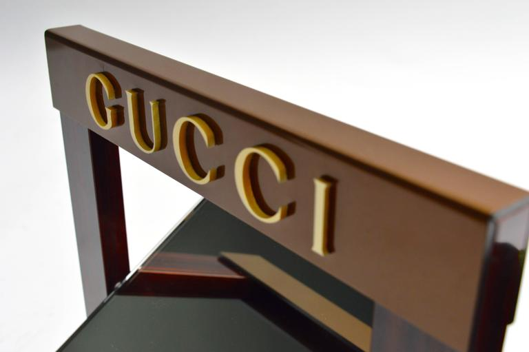 Vintage Gucci dealer mirror. Most likely used by Gucci as a store display. Front of glass is in perfect condition. Backing has a crack and has been glued. Slight cracking to one of the letters on the front. Very unique piece in very good vintage