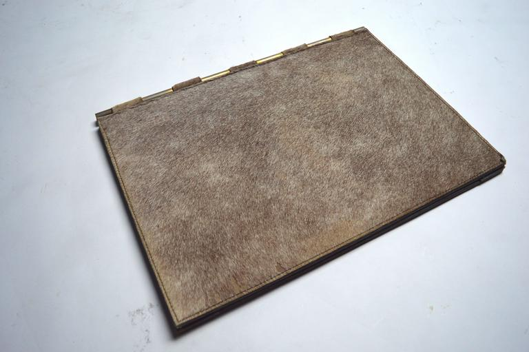Unique French desk pad lined in horse hair. Leather base with brass hardware. Small hair loss in a few areas. Underside of pad is a bit rippled from age. Not noticeable at all unless the pad is turned upside down. Good vintage condition.