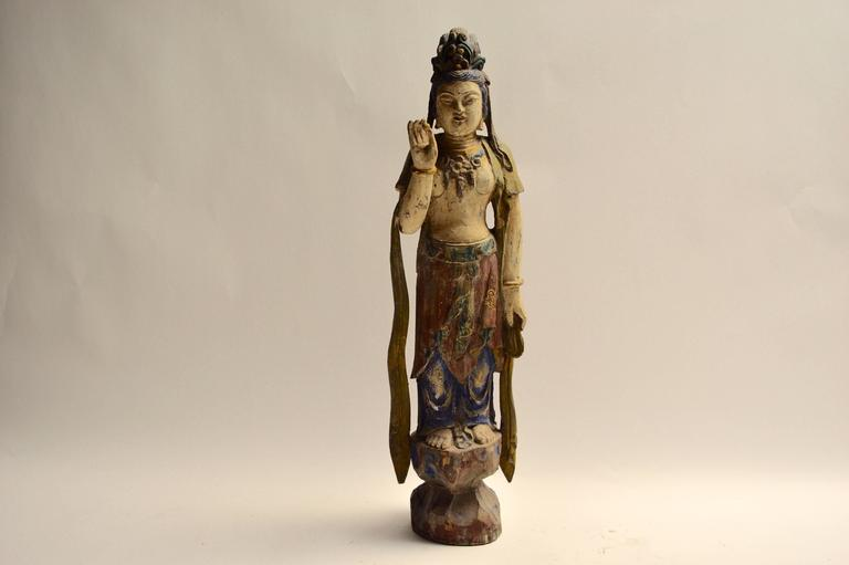 Beautiful polychrome wood sculpture with great colors. Very tranquil piece. Excellent vintage condition.