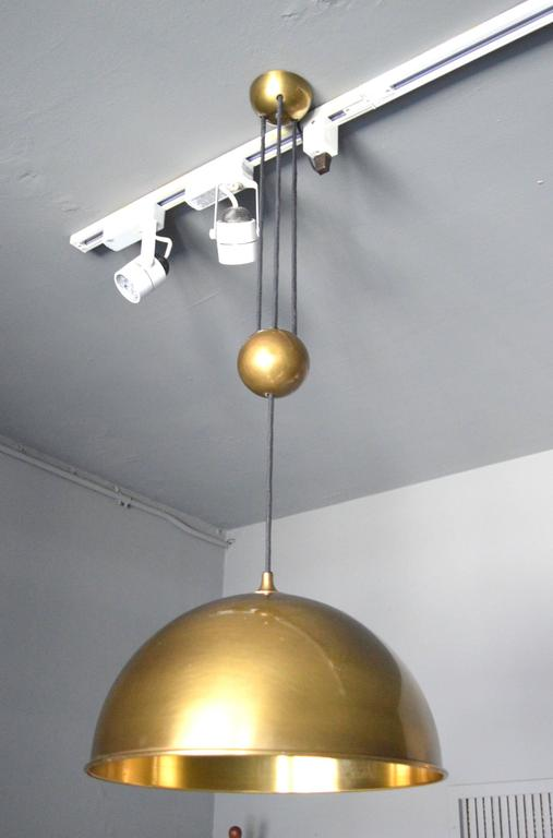 Fantastic vintage brass dome counter balance pendant by Florian Schulz. Brass dome canopy, brass ball counter-weight and brass dome. Cloth cord. Excellent patina to brass. Excellent vintage condition. Overall height is adjustable from 24