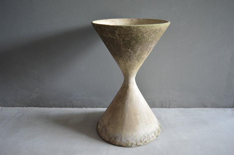 Classic hourglass planter by Swiss designer Willy Guhl for Eternit. Gorgeous patina to cement. Excellent vintage condition. Multiple pots available in this size.  Over a 150 Willy Guhl pieces available in our other listings.