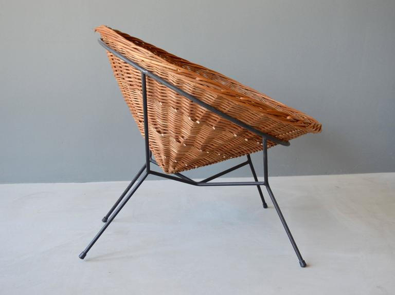 French sculptural rattan and iron chair. Handwoven cone shaped rattan seat sits freely inside the iron frame. One of a kind, prototype chair. Very good vintage condition.