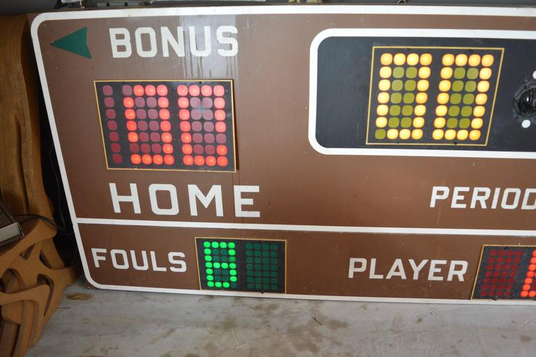 Massive 12 foot long vintage basketball scoreboard by Fair Play in the 1970s. In great working order with controller to adjust score, running shot clock etc. Working Horn. Very fun piece of art for your home or commercial space. Taken down from a
