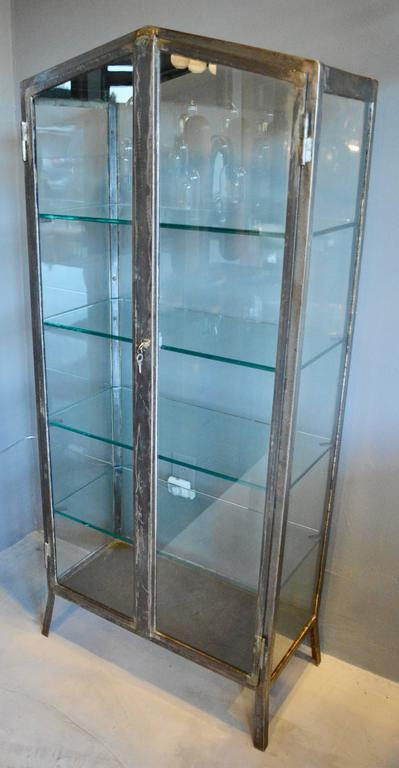 Handsome iron and glass vitrine made in the 1930s in Buenos Aires. All original iron and glass frame. Newly made thick glass shelves with notched corners to fit snugly inside. Fantastic display cabinet. Other vitrines available in separate listings.