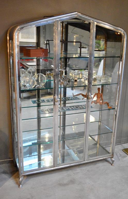 Massive iron and glass vitrine from South America, circa 1930s. Excellent vintage condition. Newly made tempered glass shelves. Claw feet in front. Working built in light, newly rewired. Six other vitrines available in separate listings.