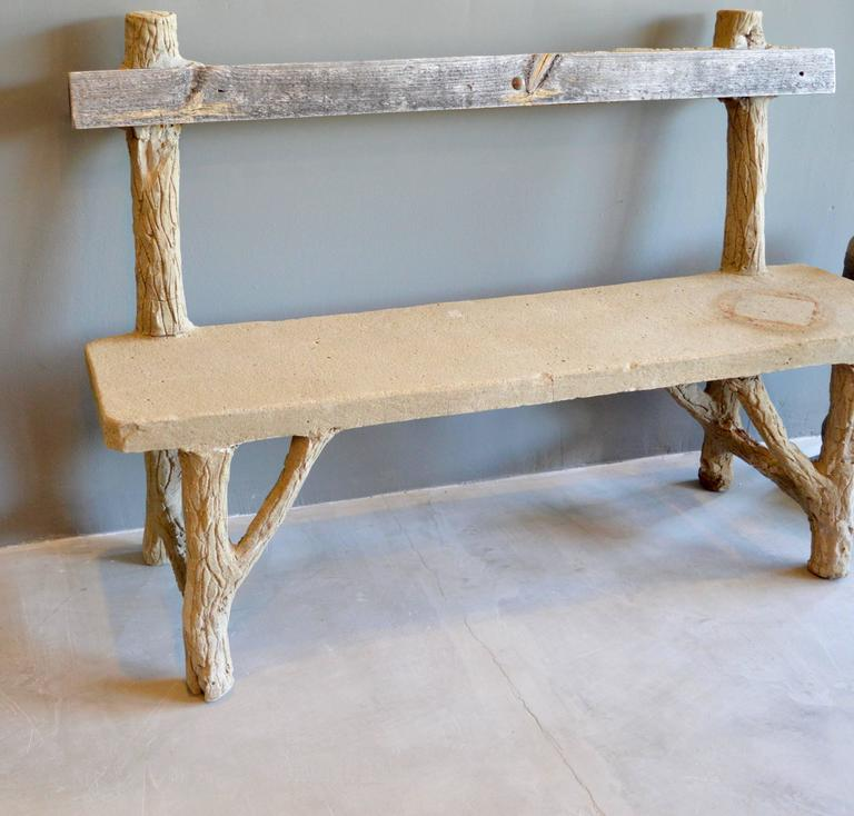 Fantastic concrete Folk Art bench. Entire bench is made of concrete except one wood plank backrest. Frame simulates wood logs with a flat slab seat. Some losses throughout. Very good vintage condition. Very unique piece. Great coloring. Perfect for