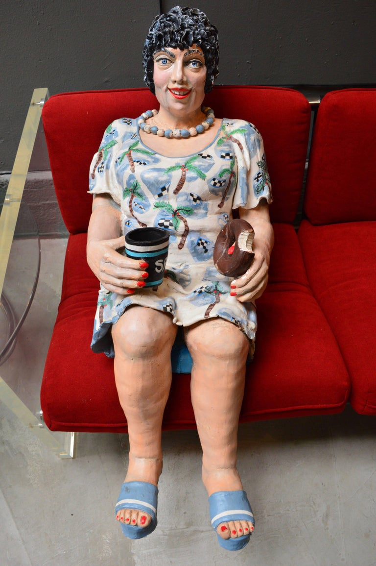 Beautiful life sized plaster sculpture by Estelle Tieman. An elderly woman named Sadie with a donut and coffee in hand. She's wearing a Hawaiian Mumu dress and a necklace.  Its a fantastic sculpture with a ton of presence. Very heavy. Signed 95'.