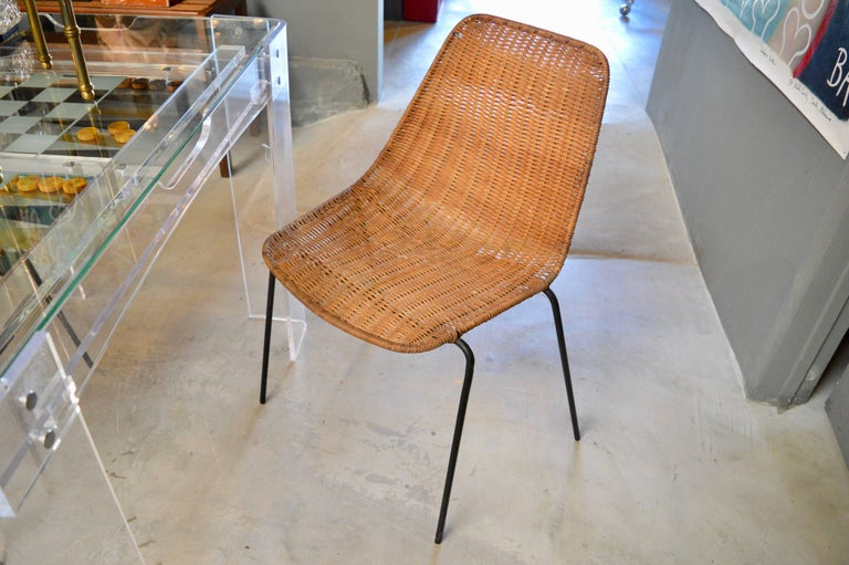 Italian wicker and iron chairs by Franco Campo and Carlo Graffi. Excellent vintage condition. Classic design. Three available. Priced individually.
