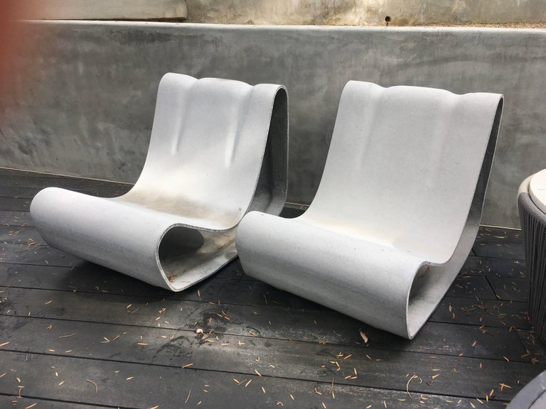 Fantastic pair of cement chairs by Swiss designer Willy Guhl for Eternit. Brand new. Hand made in Switzerland,. Newly produced. Priced as a pair. One of the most iconic chairs ever designed.