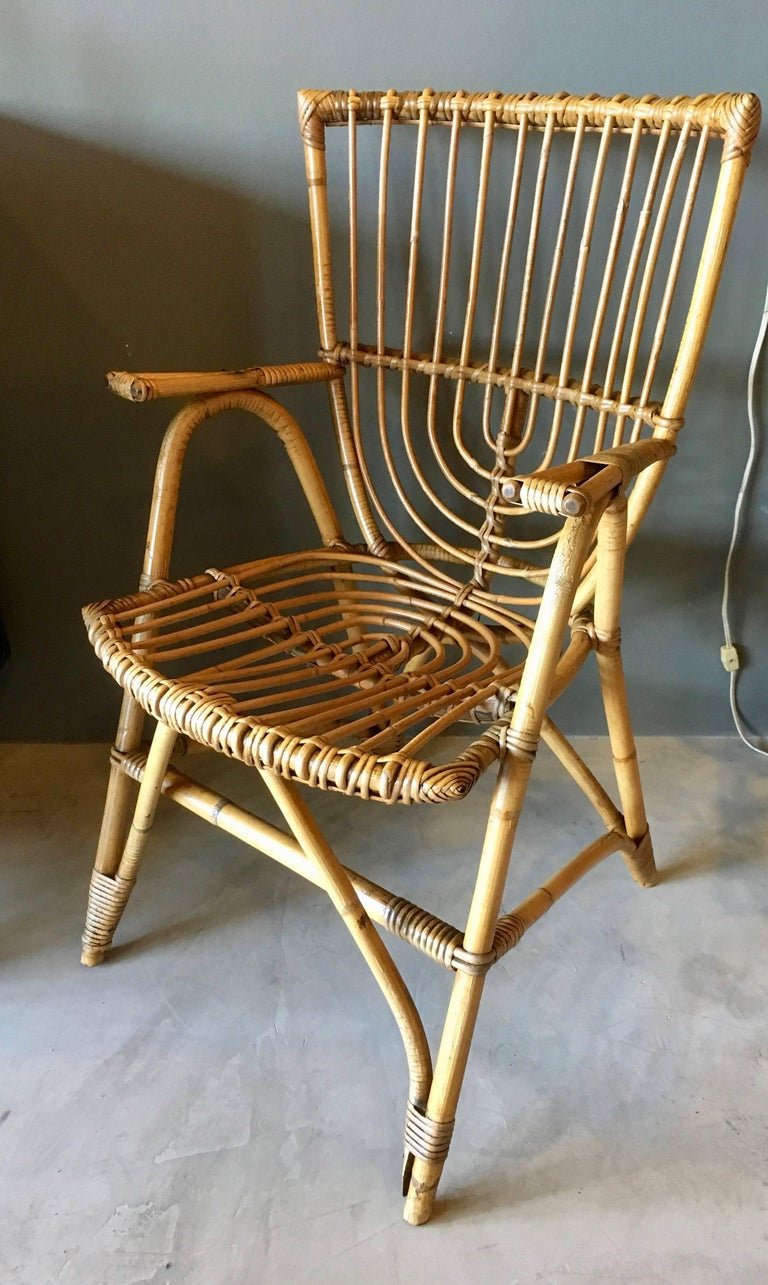 Gorgeous pair of sculptural French rattan and bamboo armchairs. Great vintage condition and coloring. Good lines.