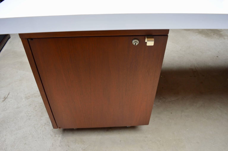 Fantastic desk by George Nelson for Herman Miller. Newly laminated Formica top with dry erase laminate. Very cool, dry/erase surface for your work desk. Extremely functional and unique feature. Walnut desk with chrome hardware. Two drawer pedestal