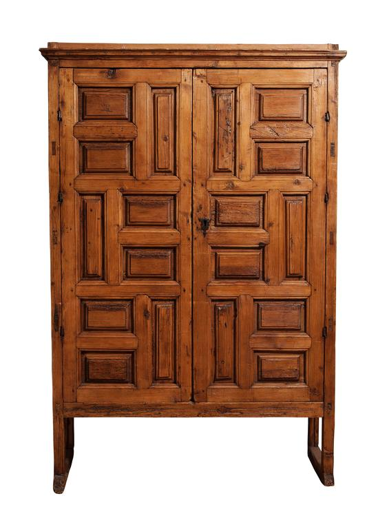 18th century Mexican carved pine armoire. Beautiful, masculine character and aged to perfection.