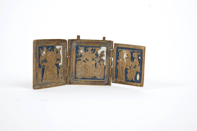 19th century Russian three-panel traveling icon. Brass with blue enamel. Dimensions when open are 6.25