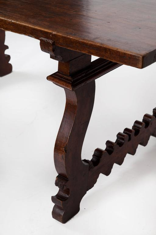 Beautiful 18th century dark Italian walnut table with lyre legs. Great patina. The top has several nicely placed mends.