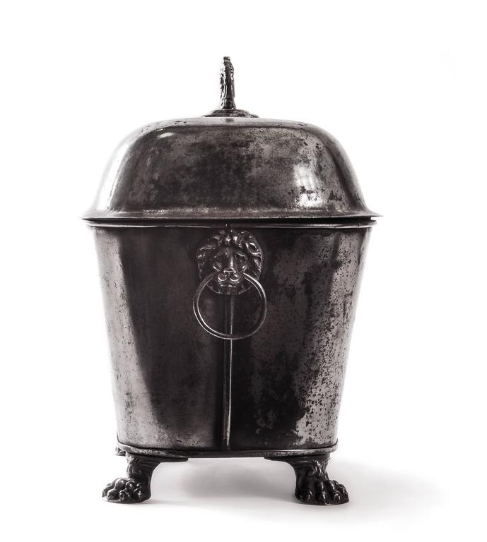19th century English coal scuttle. Polished steel. Raised on four claw feet. Two lion decorated handles.