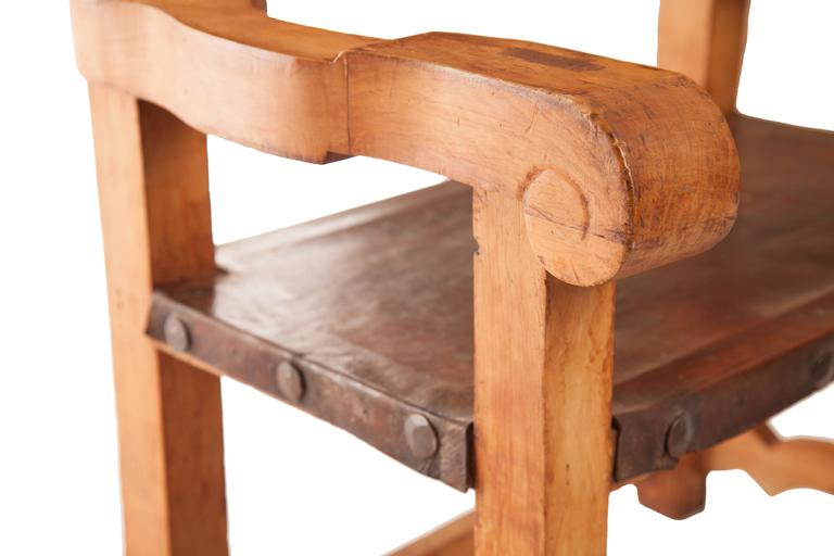 This lovely Frailero chair is from the estate of the renowned Mexican designer Hector Aguilar, circa 1940, made of Sabino pine wood and leather, there is a lovely copper repousse piece set into the inside back.