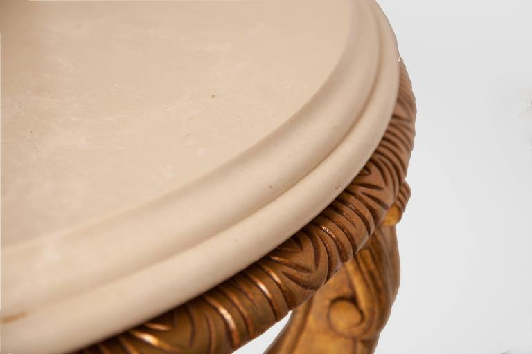French Louis XV style giltwood and marble round table.
