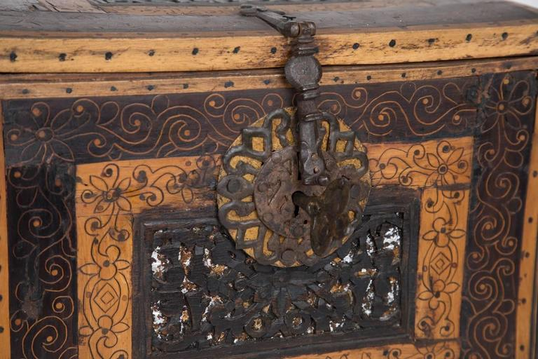 Magnificent 18th century Bolivian locking escritorio with inlaid wood and hand-forged iron details.