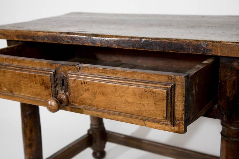 Lovely rustic walnut low table with one drawer, English, 18th century.
