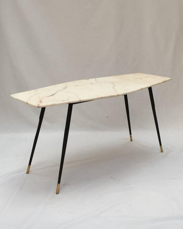 A marble coffee table with brass tipped black