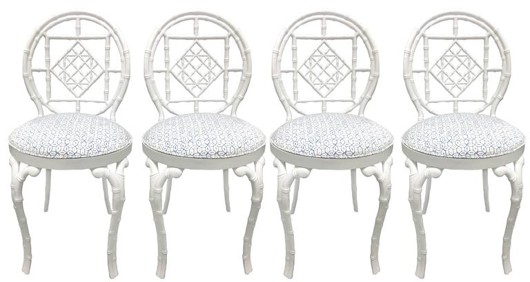 Pair of faux bamboo metal chairs by Kessler. White powder coated finish. Newly upholstered in quadrille suncloth 'Melong Batik' in pale blue or white. Suitable for indoor or outdoor use. Signed