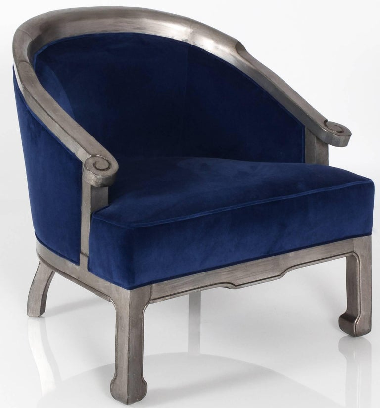 Pair of 1970s chinoiserie barrel back armchairs. Custom antique silver painted frame. Newly upholstered in sapphire blue velvet.