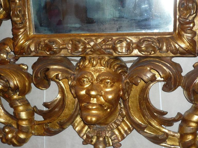 Rare Roman Baroque Carved and Giltwood Mirror, with a Grotesque Head, 1700 3