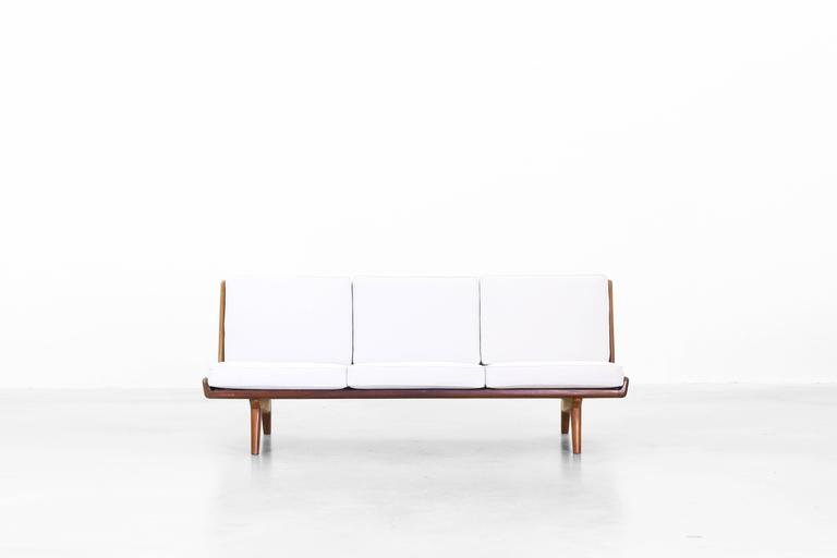 Very beautiful sofa designed by Carl Gustaf Hiort af Ornäs, Sweden in 1950. The sofa is in a very good condition. The cushions were newly reupholstered with a high quality fabric by