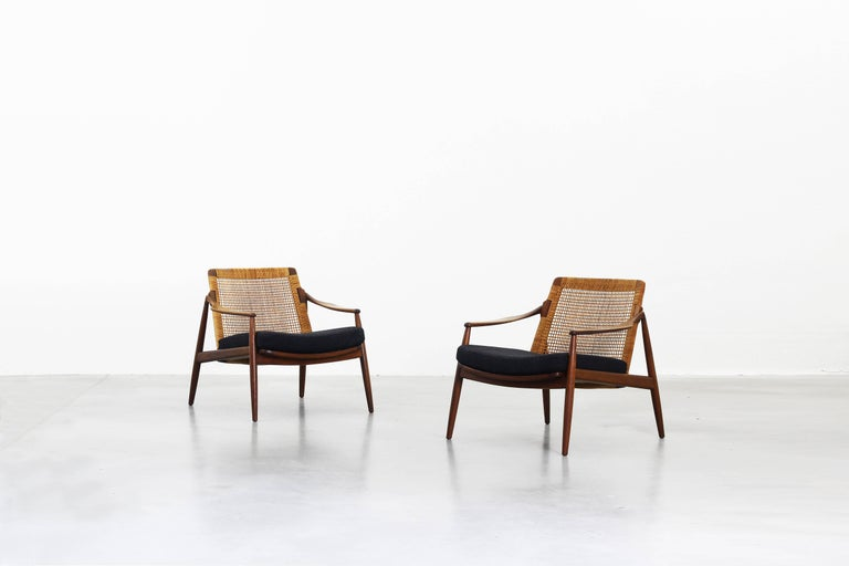 Very beautiful lounge chairs designed by Hartmut Lohmeyer for Wilkhahn in the 1950s, made in Germany. Very beautifully shaped, newly reupholstered with a high quality fabric by Kvadrat in dark grey, the cane and the teak wood frame are in an