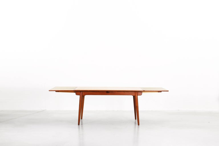 Very beautiful dining table mod. 312 designed by Hans J. Wegner and produced by Andreas Tuck in the 1950s. This table comes with two extensions (L 140 cm + 2 x 50 cm x W 90 cm x 72 cm), is in a very good condition and is made of teak.
