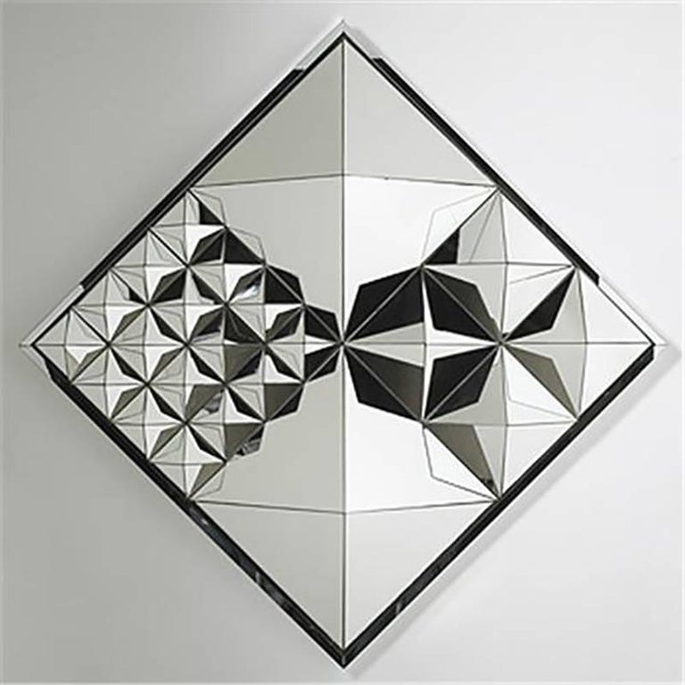 Verner Panton Diamond pyramid mirror, circa 1974 Mirrored glass, painted wood. Measures: 32 3/4 x 32 3/4 x 8 1/2 in. (83.2 x 83.2 x 21.6 cm) Manufactured by Beylerian, USA Beautiful piece in excellent condition  The sculptured wall mirror is