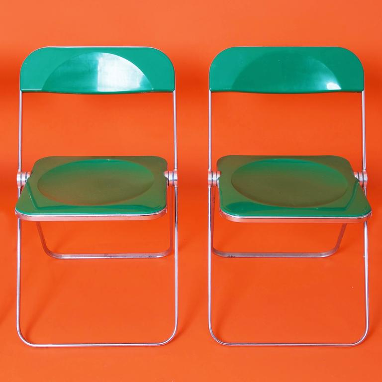 Rare pair of plia folding chairs designed by Giancarlo Piretti for Castelli in 1969.  The seat is made of chrome frame with green ABS seating and back. The chairs come in good original condition.