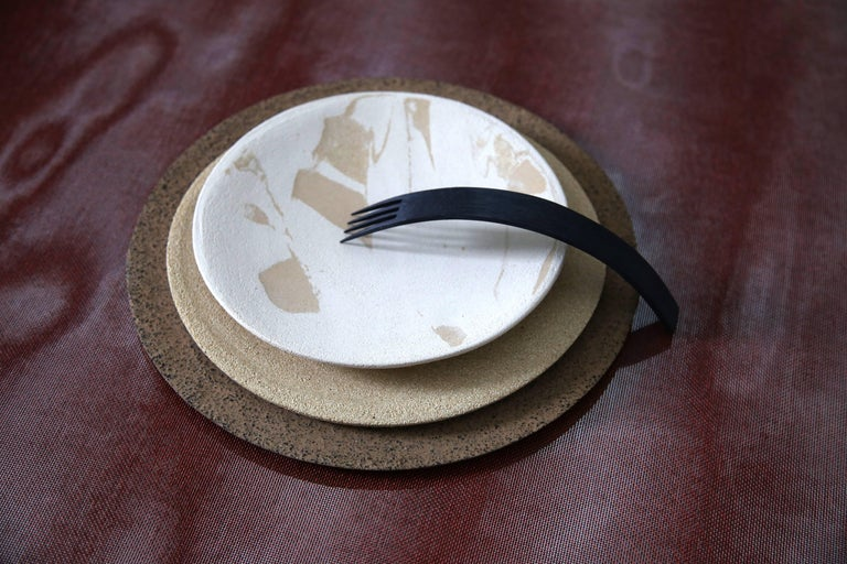 Handmade in Denmark. Pure stoneware clay, no added color  From the series 'Things That Never Made It To The Table'  Christel Thue asks: Why must plates be identical? Why does a wineglass have a stem? Why is the tableware composition always the